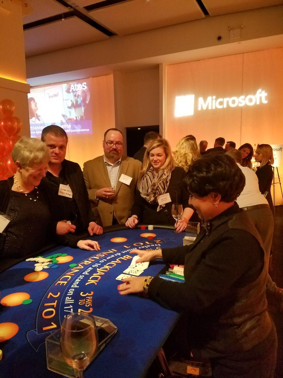 casino party with blackjack table and dealer